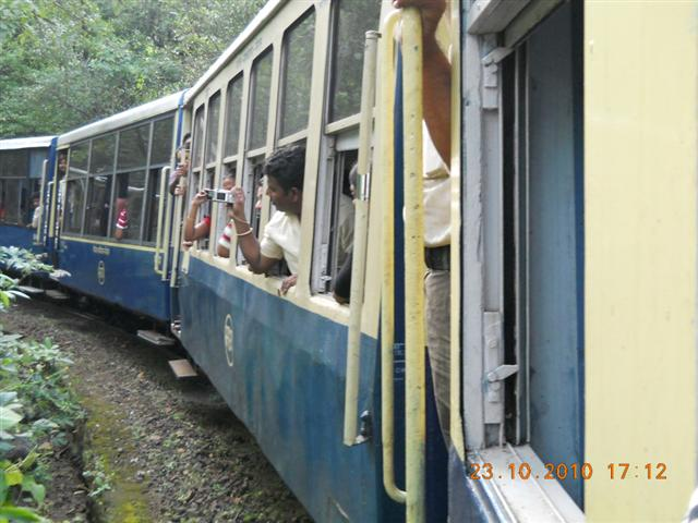 People Clicking Pictures While Riding the Train