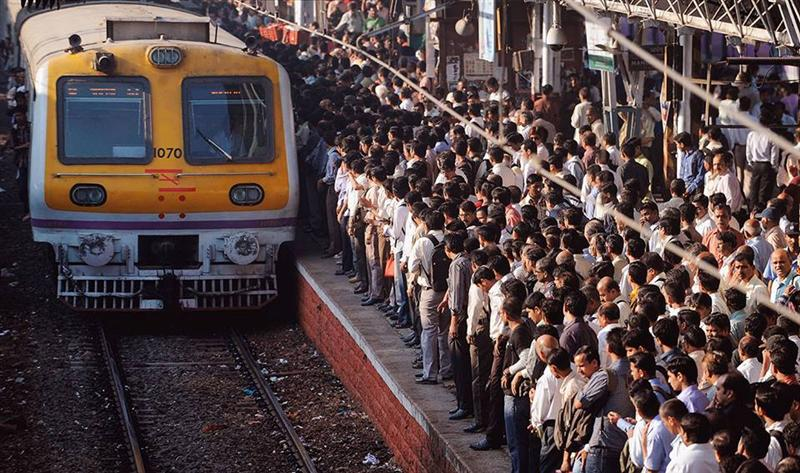 Train Entering On Crowded Platform