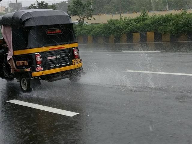 Mumbai's Iconic Auto During Rain