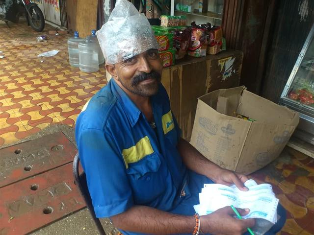 A Gas Delivery Man Wearing Plastic Cap During Rain