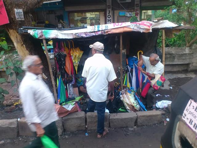 An Umbrella Repair Shop on Mumbai Street