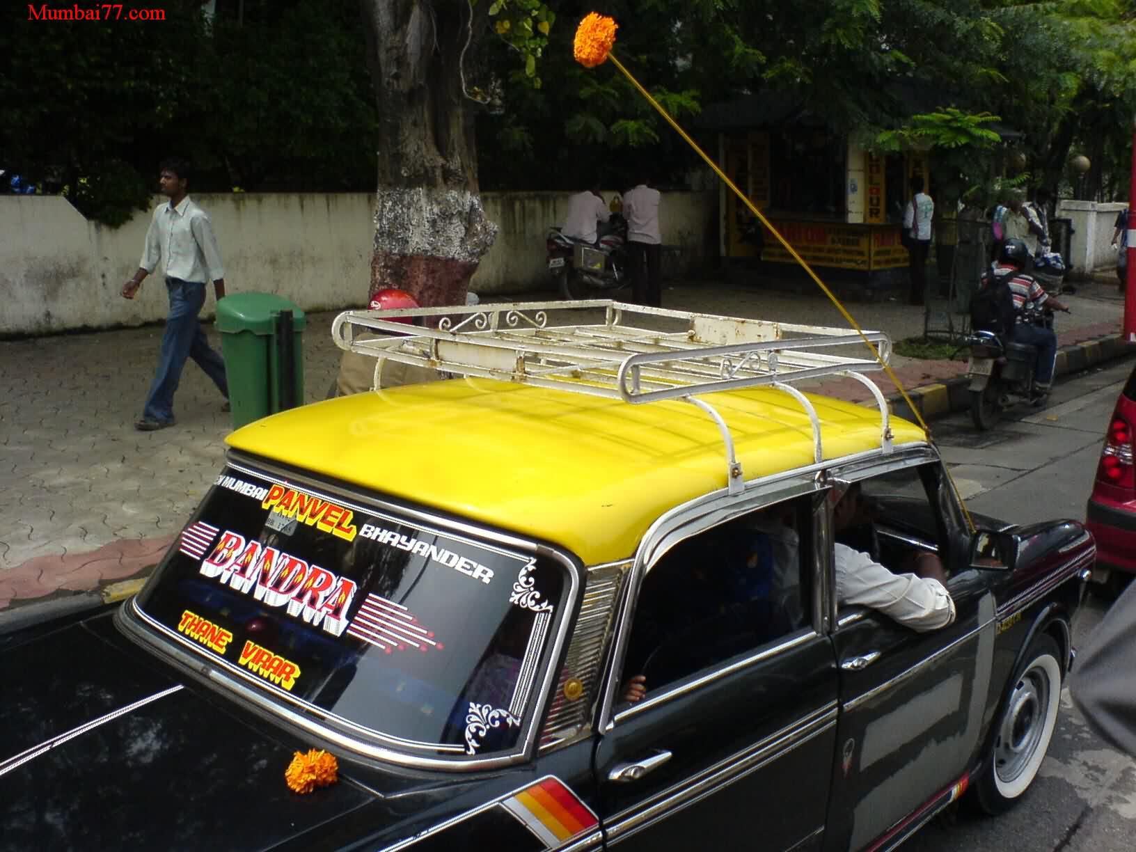 Yellow Black Taxi in Mumbai