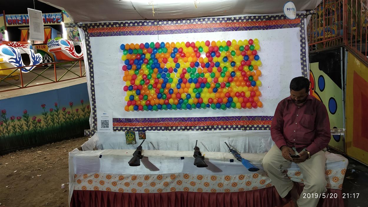 Balloon Shooting With Gun In Mela Fair
