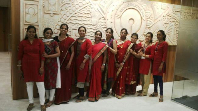 A Ladies Group Wearing Red Colour Outfits