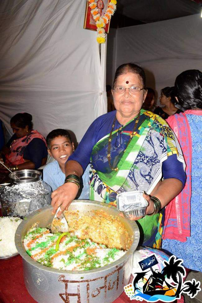 Elderly Aaji Serving Biryani